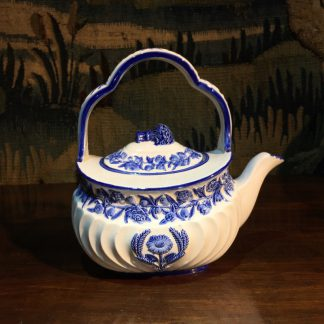 Wedgwood creamware kettle, moulded flowers picked out in blue, dated 1879 -0