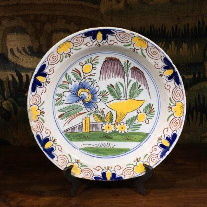 English delft plate, polychrome garden scene, c. 1750-0