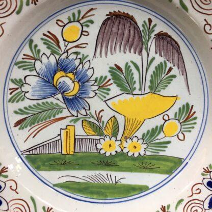 English delft plate, polychrome garden scene, c. 1750-29450