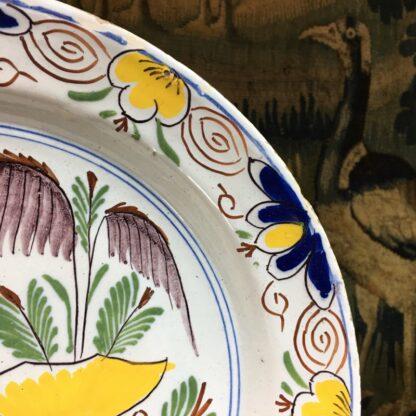 English delft plate, polychrome garden scene, c. 1750-29449