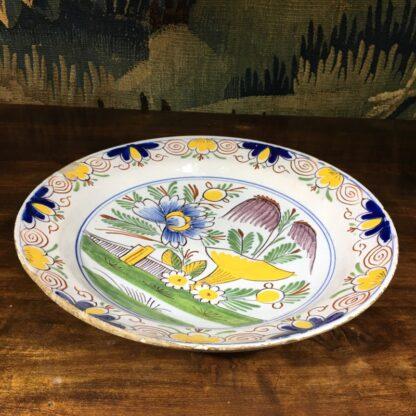English delft plate, polychrome garden scene, c. 1750-29455