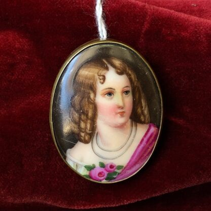 Porcelain plaque, portrait of a girl, mounted as a brooch, C. 1880 -0