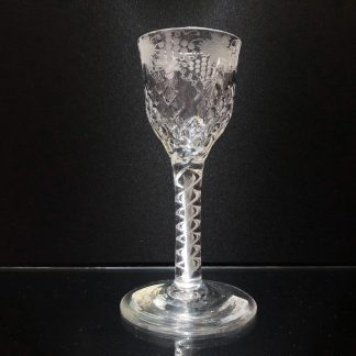 Georgian airtwist wine glass, honeycomb bowl engraved with fruiting vine, c.1790-0