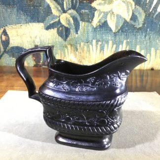 Black Basalt milk jug, strawberry moulded, c. 1820. -0