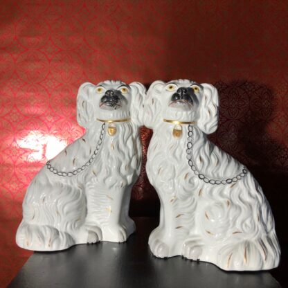 Pair of Staffordshire spaniels, white with fine moulding, c. 1875. -31895