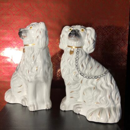 Pair of Staffordshire spaniels, white with fine moulding, c. 1875. -31891