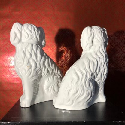 Pair of Staffordshire spaniels, white with fine moulding, c. 1875. -31893