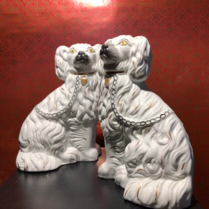 Pair of Staffordshire spaniels, white with fine moulding, c. 1875. -31898