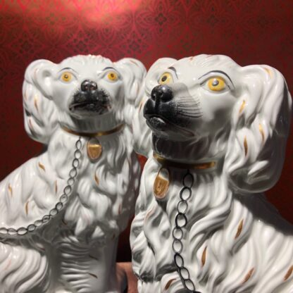 Pair of Staffordshire spaniels, white with fine moulding, c. 1875. -31894