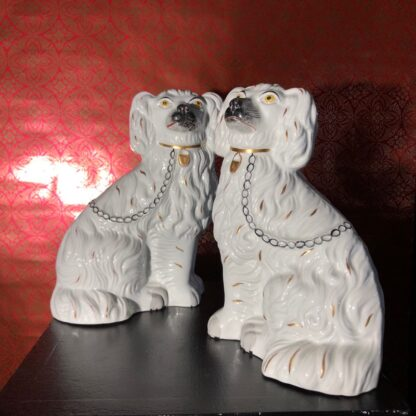 Pair of Staffordshire spaniels, white with fine moulding, c. 1875. -31892