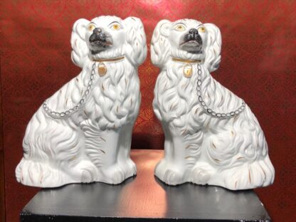 Pair of Staffordshire spaniels, white with fine moulding, c. 1875. -0
