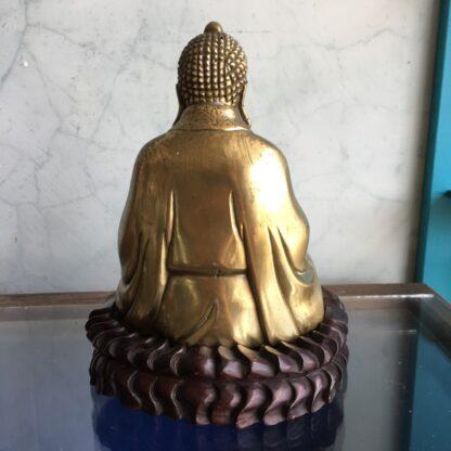 Oriental sitting brass Buddha on carved stand, C. 1900-32206