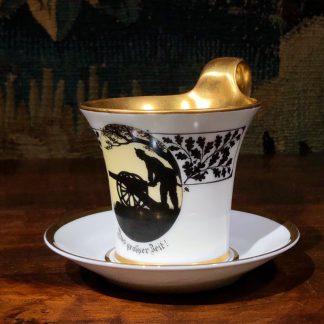 Furstenberg cup & saucer, silhouette Prussian soldier & cannon, 'Aus grosser Beit' c. 1920 -0