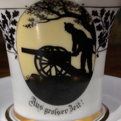 Furstenberg cup & saucer, silhouette Prussian soldier & cannon, 'Aus grosser Beit' c. 1920 -32400