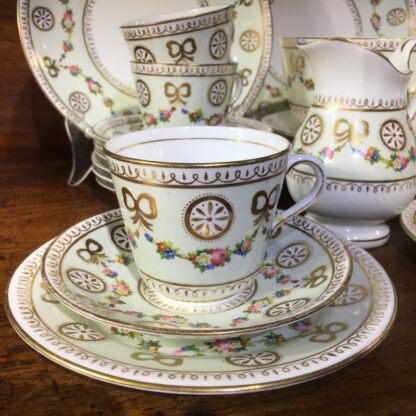 English tea set for 8, hand painted flower garlands, gilt bows & pinwheels , c.1880-33811
