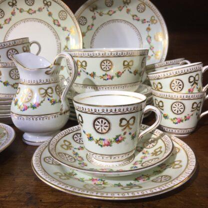 English tea set for 8, hand painted flower garlands, gilt bows & pinwheels , c.1880-33813