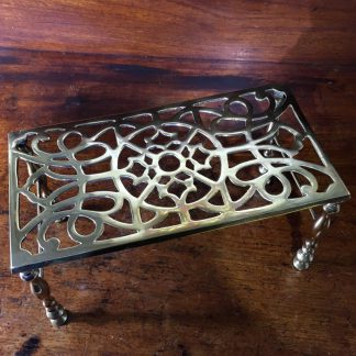 Georgian brass trivet, with four legs, pierced top, c.1800-0