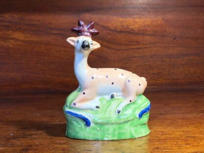 Staffordshire figure of a seated deer, c. 1810-33993