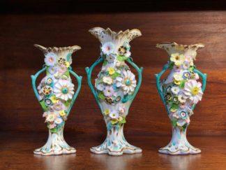 Garniture of flower encrusted vases, prob. Samuel Alcock, c. 1840-0