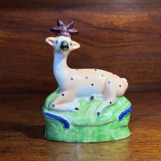 Staffordshire figure of a seated deer, c. 1810-0