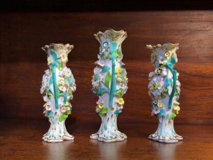 Garniture of flower encrusted vases, prob. Samuel Alcock, c. 1840-33945