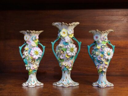 Garniture of flower encrusted vases, prob. Samuel Alcock, c. 1840-33941
