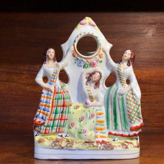 Staffordshire figural pocketwatch holder, three dancers, c. 1865-0
